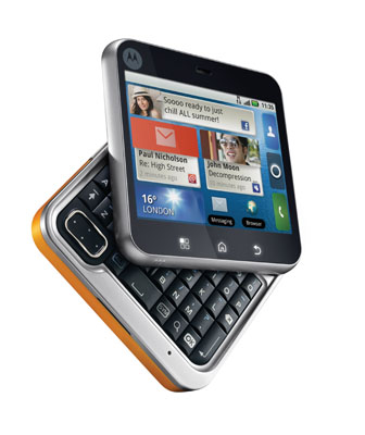 FLIPOUT_Saffron_dyn_L_partOpen_Home_EMEA_m Motorola Flipout phone not available in the USA, shaped like a square, runs Android 2.1 with 7 flipping fantastic fancy colors