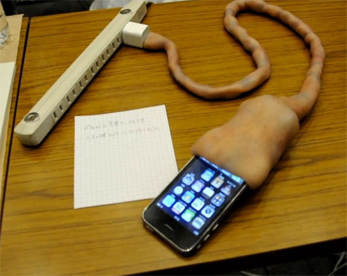 umbilical-charger Weird umbilical cord charger latches on to your iPhone