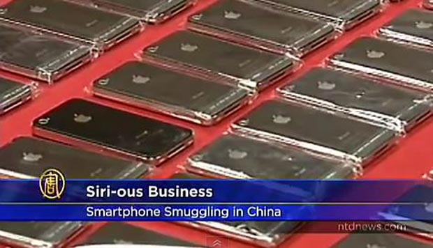 120306-china  Man Attempts to Smuggle 30 iPhones Taped To His Chest into China (Video)