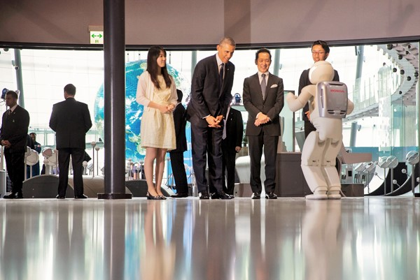 President Barack Obama watches a robot made by Honda, named ASIMO, perform during a tour of the National Museum of Emerging Science and Innovation in Tokyo.